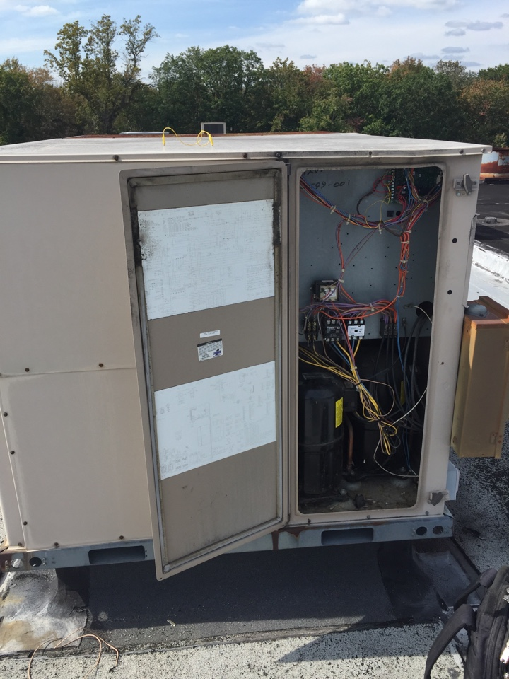 Randolph, NJ - Commercial air conditioning service call. Repair York rooftop air conditioning unit. Unit not blowing air. Replace bad circuit board, belt and contractor.