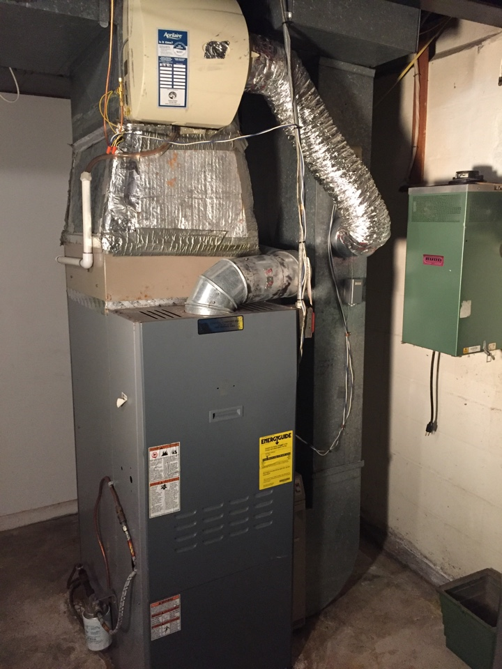 Montville, NJ - Heating service call.  Unit blow warm air.  Preventive maintance on oil fired furnace, replace Aprilaire humidifier pad, and replace condensate drain.