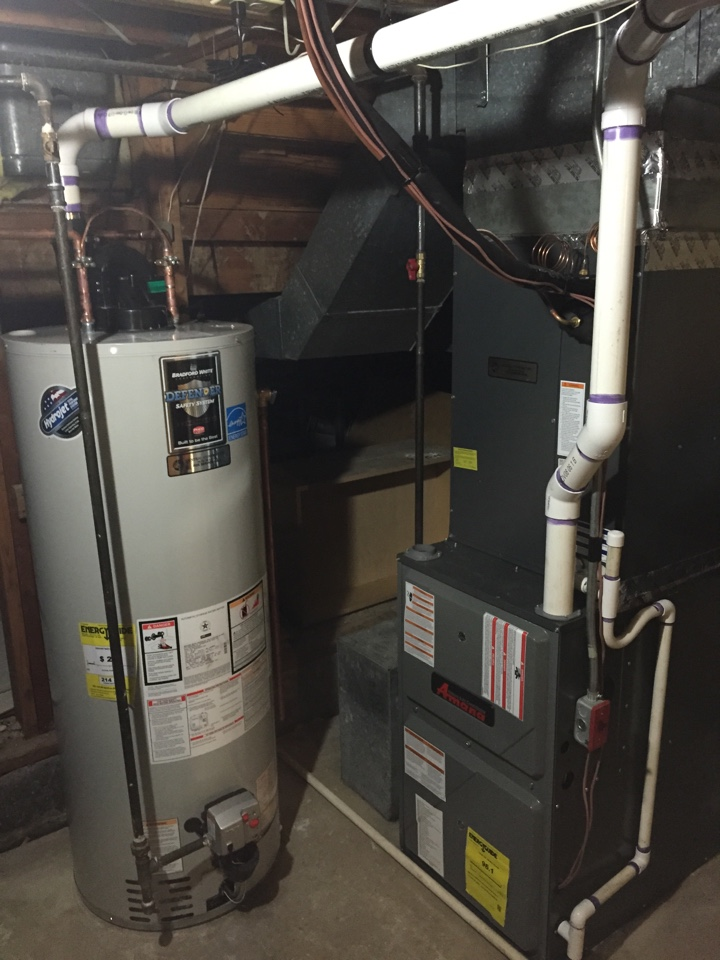Livingston, NJ - Heating preventive maintenance.  Clean and service natural gas Amana furnace and hot water heater.