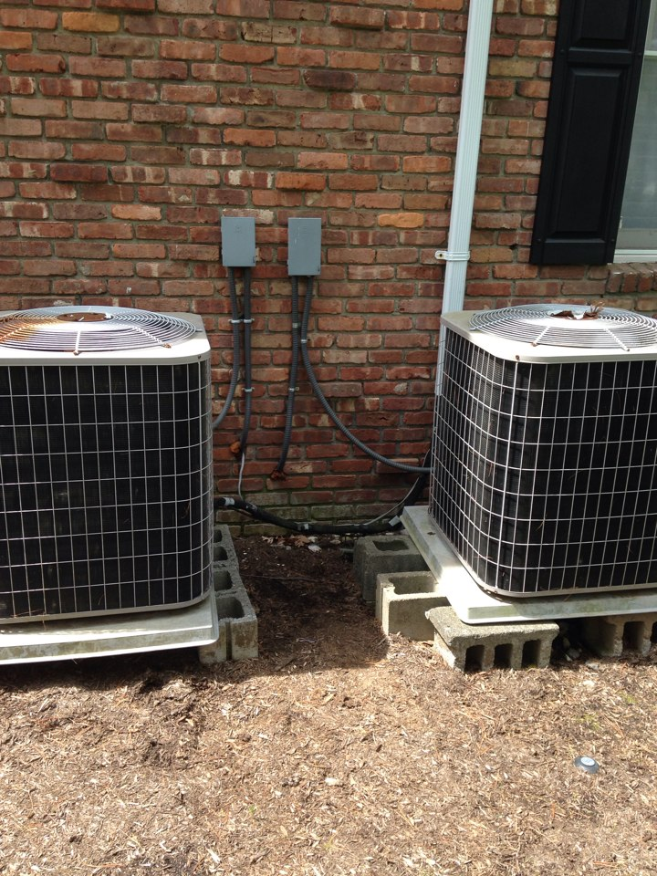 Livingston, NJ - Air conditioning service on Carrier a/c system. Replace bad capacitor with new turbo capacitor.