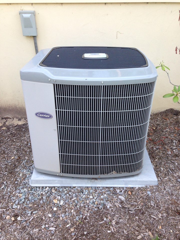 Livingston, NJ - Air conditioning service on a Carrier AC unit.