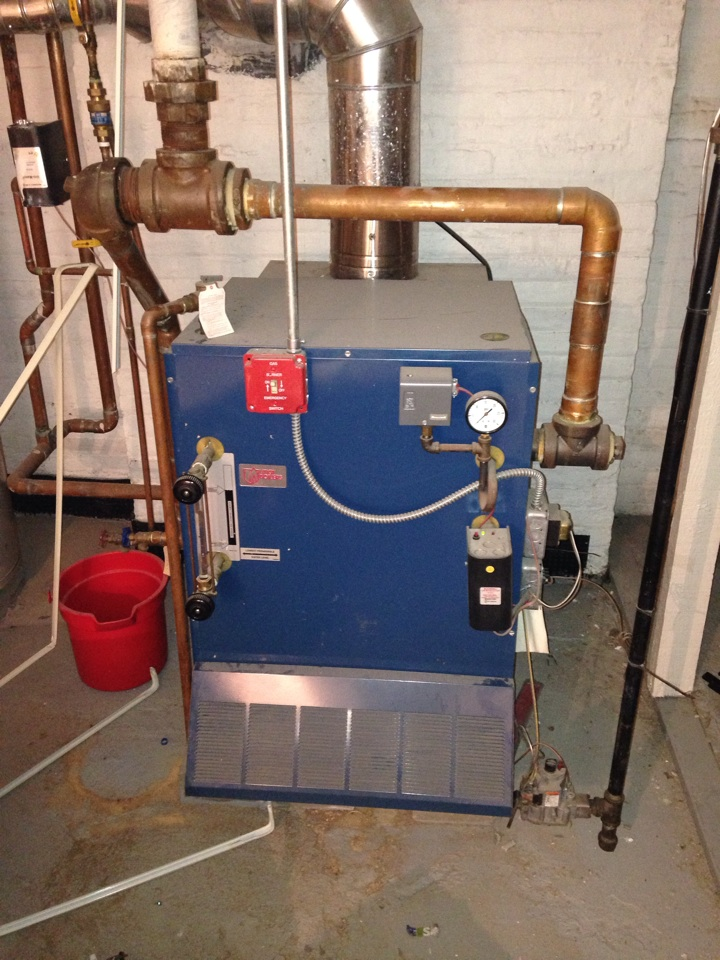 Maplewood, NJ - Clean and service preventive maintenance on Utica gas fired steam boiler.