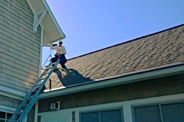 Bellaire, MI - Matthew installing gutter helmet on lake Bellaire.