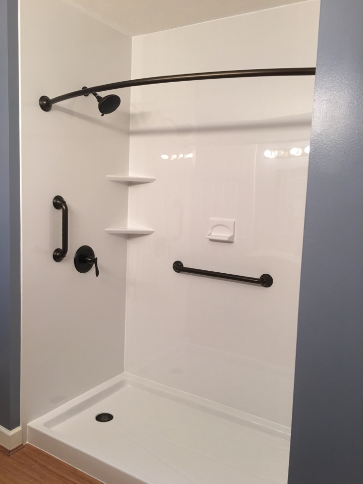 Interlochen, MI - Finished tub-to-shower, smooth white finish with oil-rubbed bronze fixtures