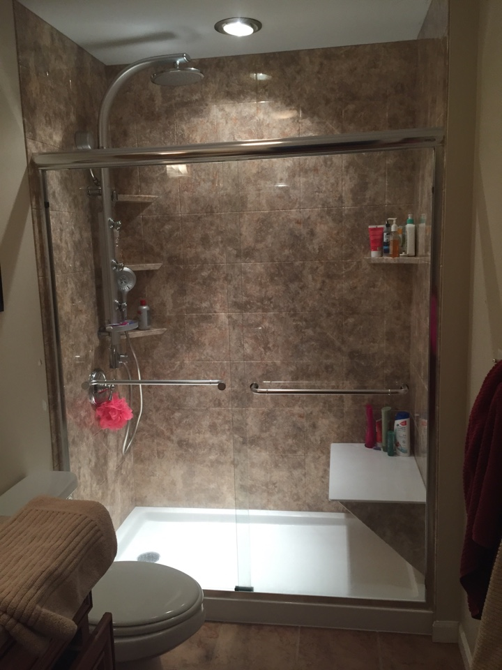 Traverse City, MI - We replaced a one piece bath tub and installed a low threshold shower with a bench seat and new fixtures.