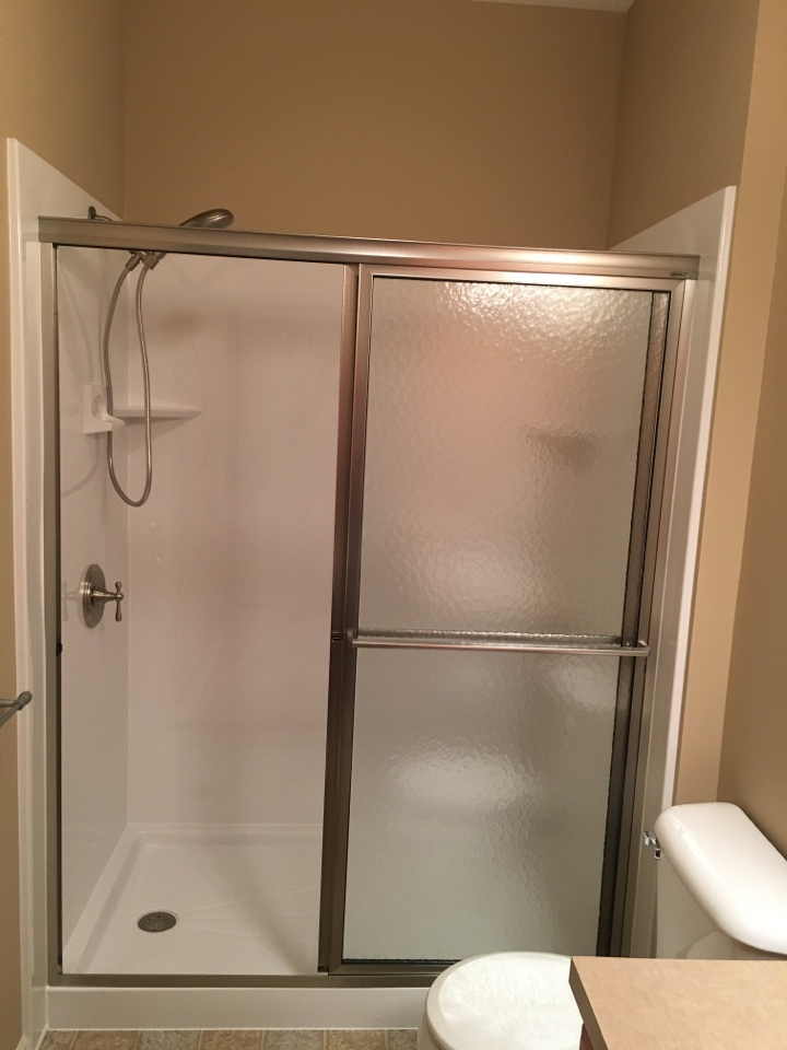 Grand Rapids, MI - Completed, acrylic white smooth walls with low threshold shower pan, brushed nickel fixtures and door
