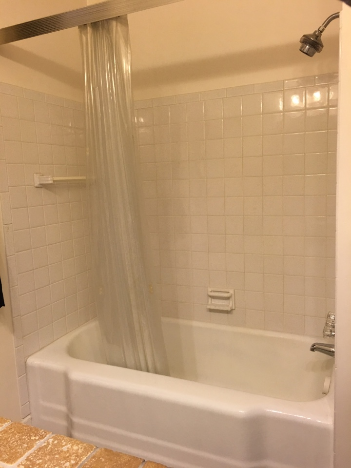 Muskegon, MI - Removing another old hard to clean cast iron tub with tile