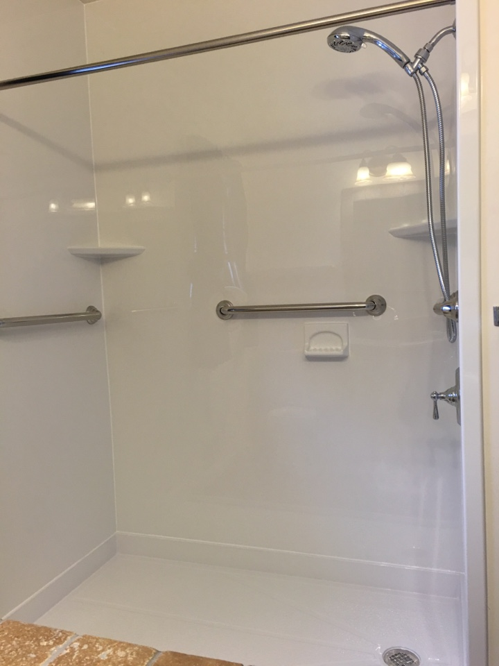 Muskegon, MI - Finished smooth white barrier free shower pan with chrome fixtures.