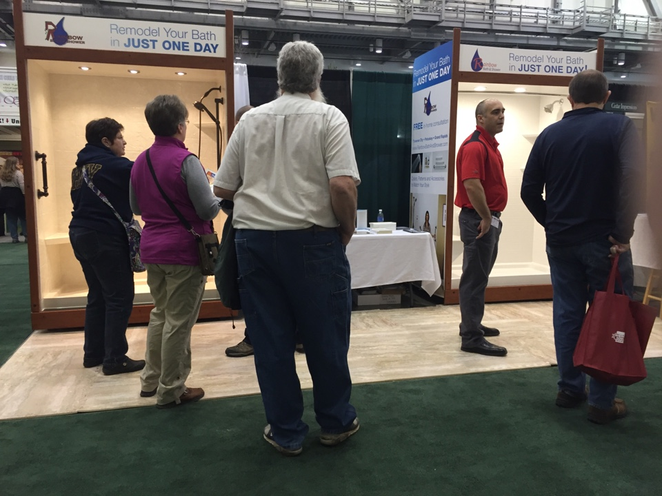 Grand Rapids, MI - At the home builders show in Grand Rapids MI. Showing off our shower models with moen fixtures and stone pattern, subway tile wall surrounds.