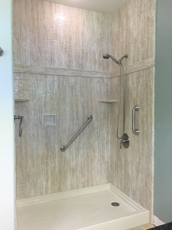 Traverse City, MI - Finished seaside marble stone pattern acrylic shower with brushed nickel fixtures