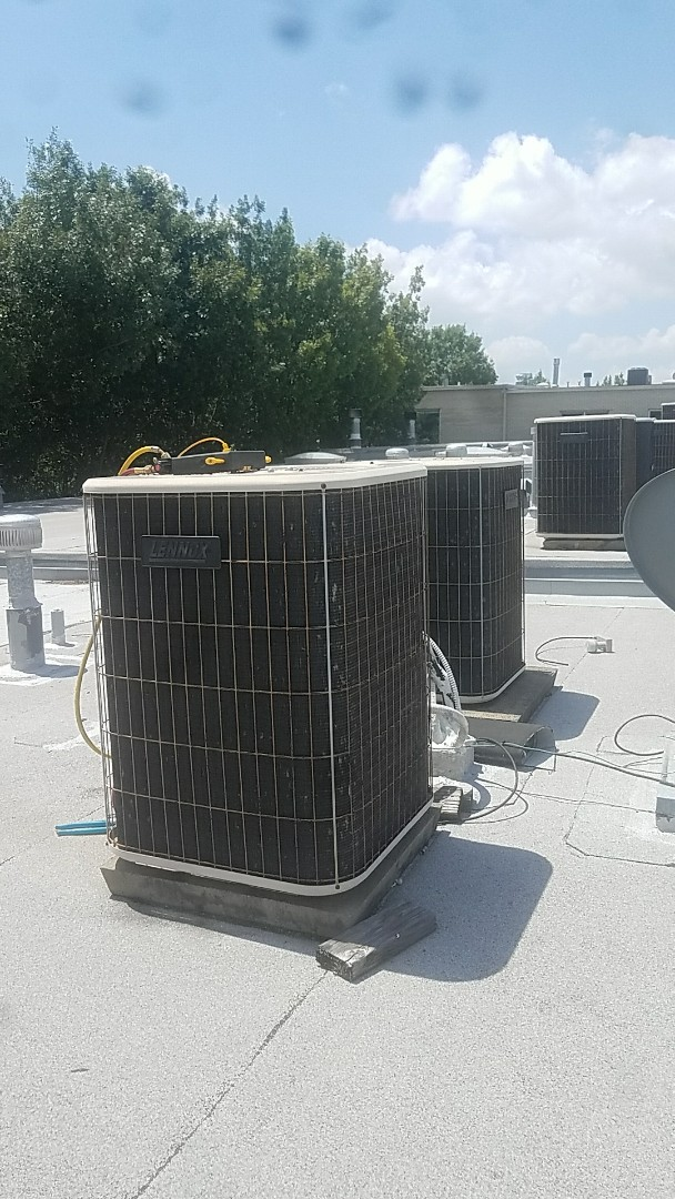 Dallas, TX - Servicing and cleaning up our customer, Elizabeth's, 2 Lennox air conditioning systems at her condo in Dallas, TX.