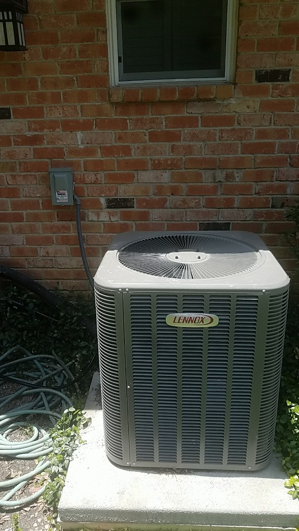 Richardson, TX -  Performing an a.c. repair for our new customer on her Lennox air conditioning system at her home in Richardson.