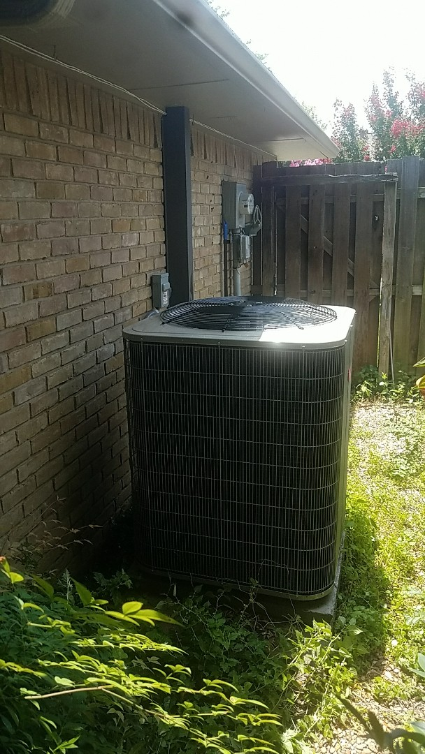 Dallas, TX - Tuning up and cleaning out our customer's new Bryant air conditioning system at their home in Dallas.
