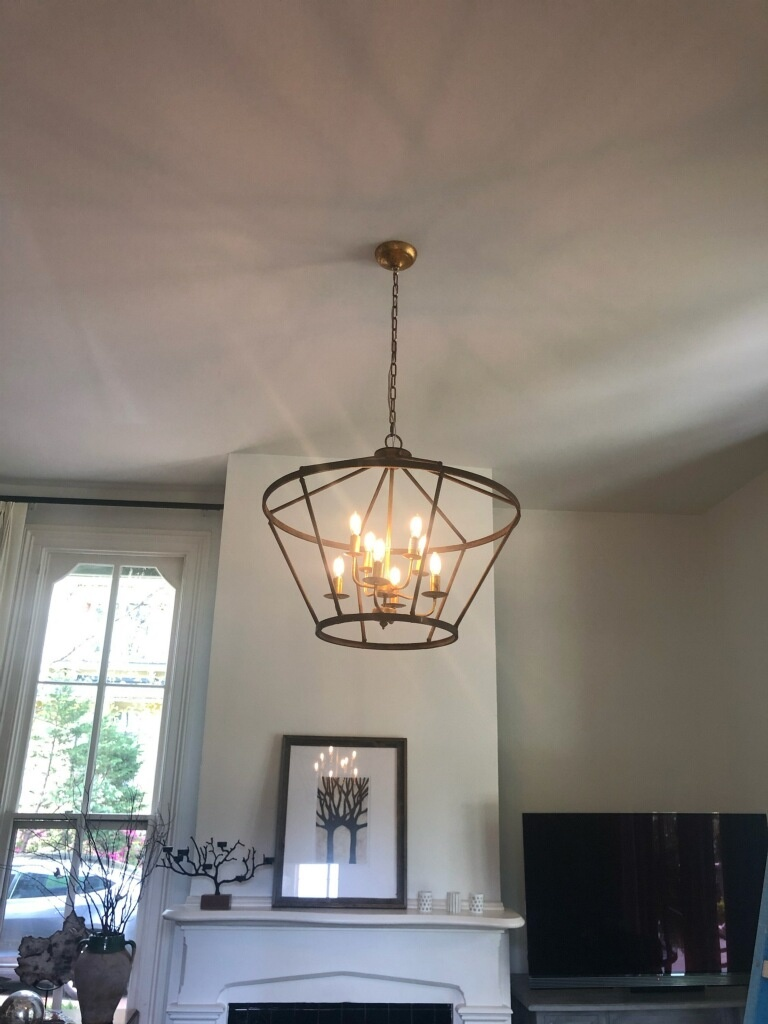 Installing customer supplies chandelier in living room