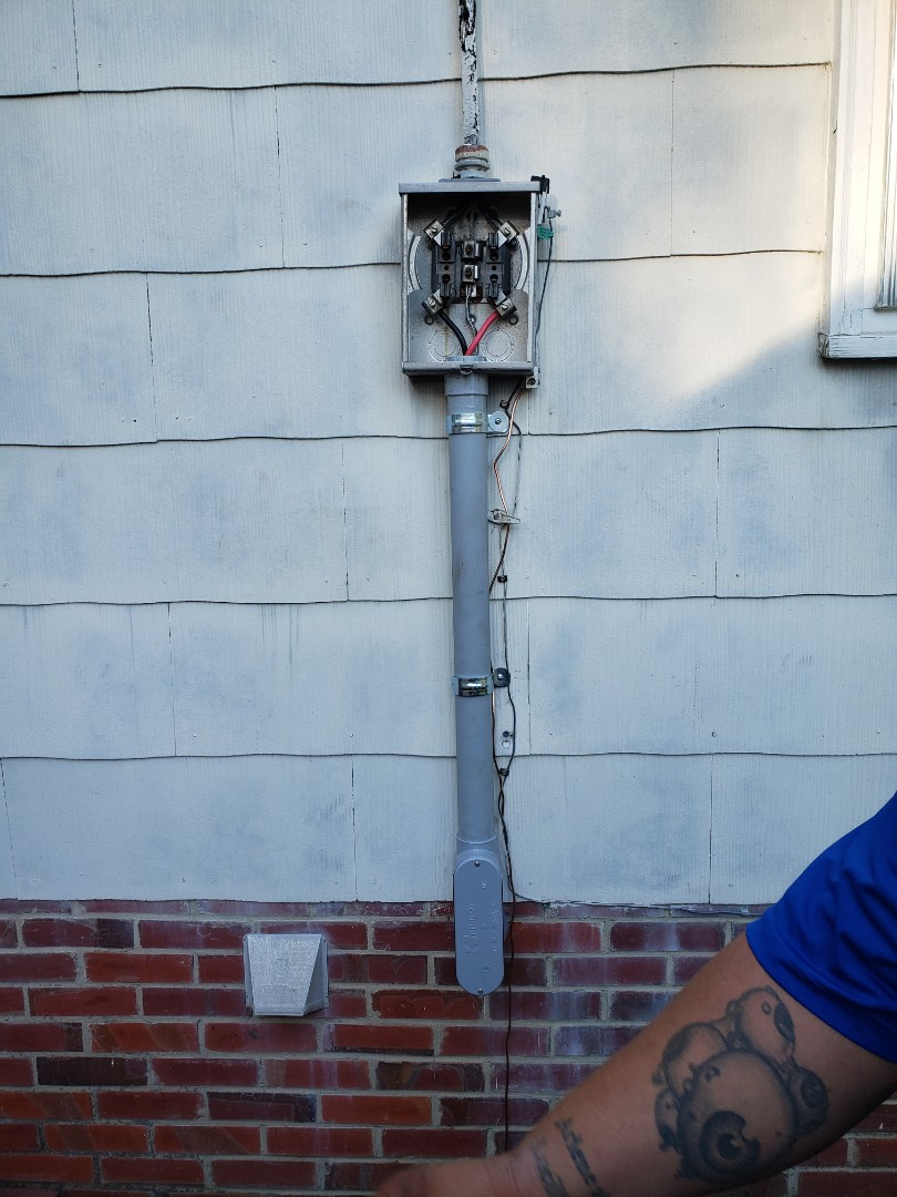 Repaired service wire from meter base to sub panel in house