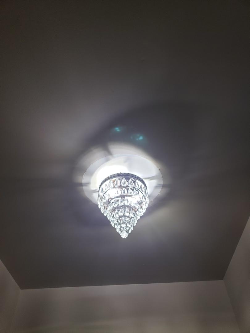 Install customer supplied light fixture in foyer
