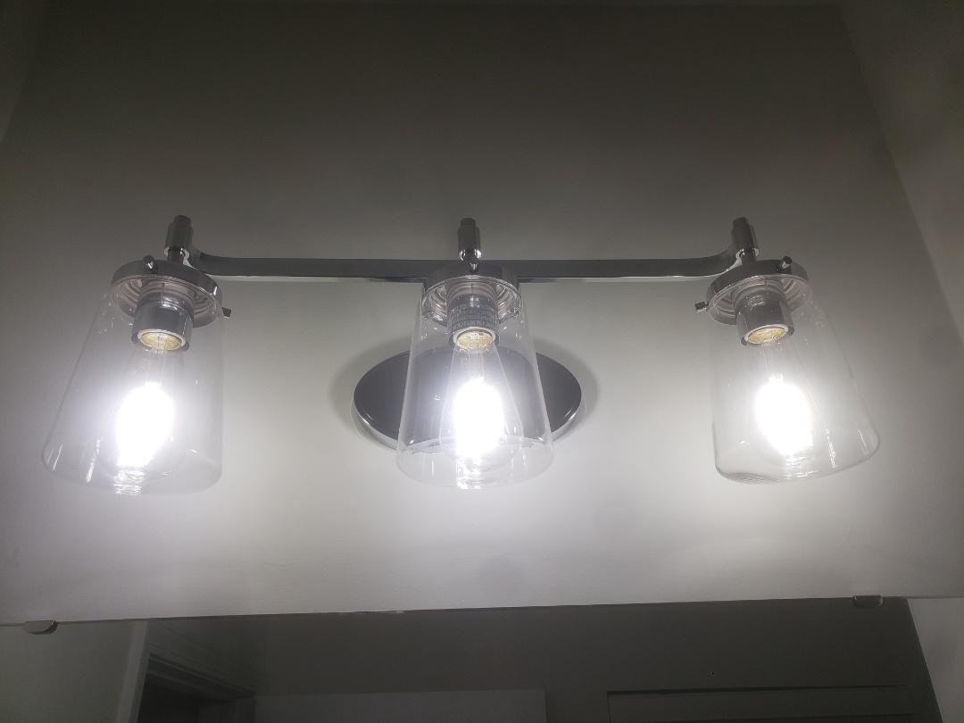 Installed customer supplied vanity light in bathroom.