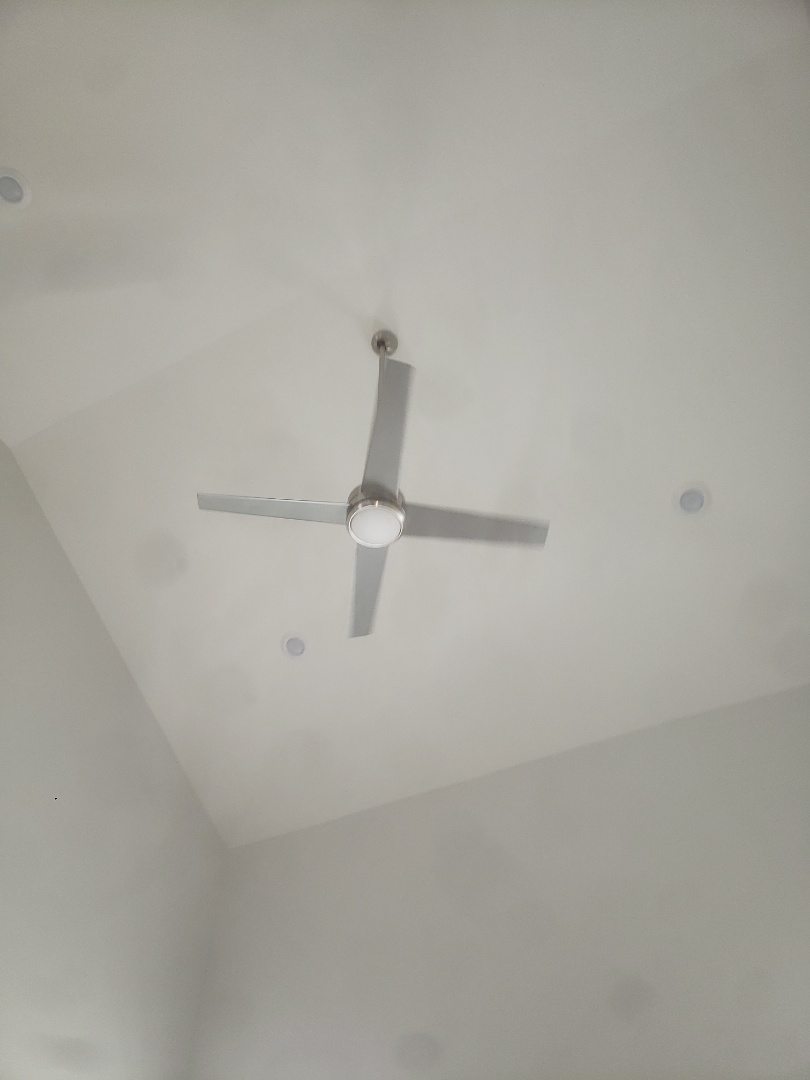 Install customer supplied ceiling fan on 20 foot sloped ceiling