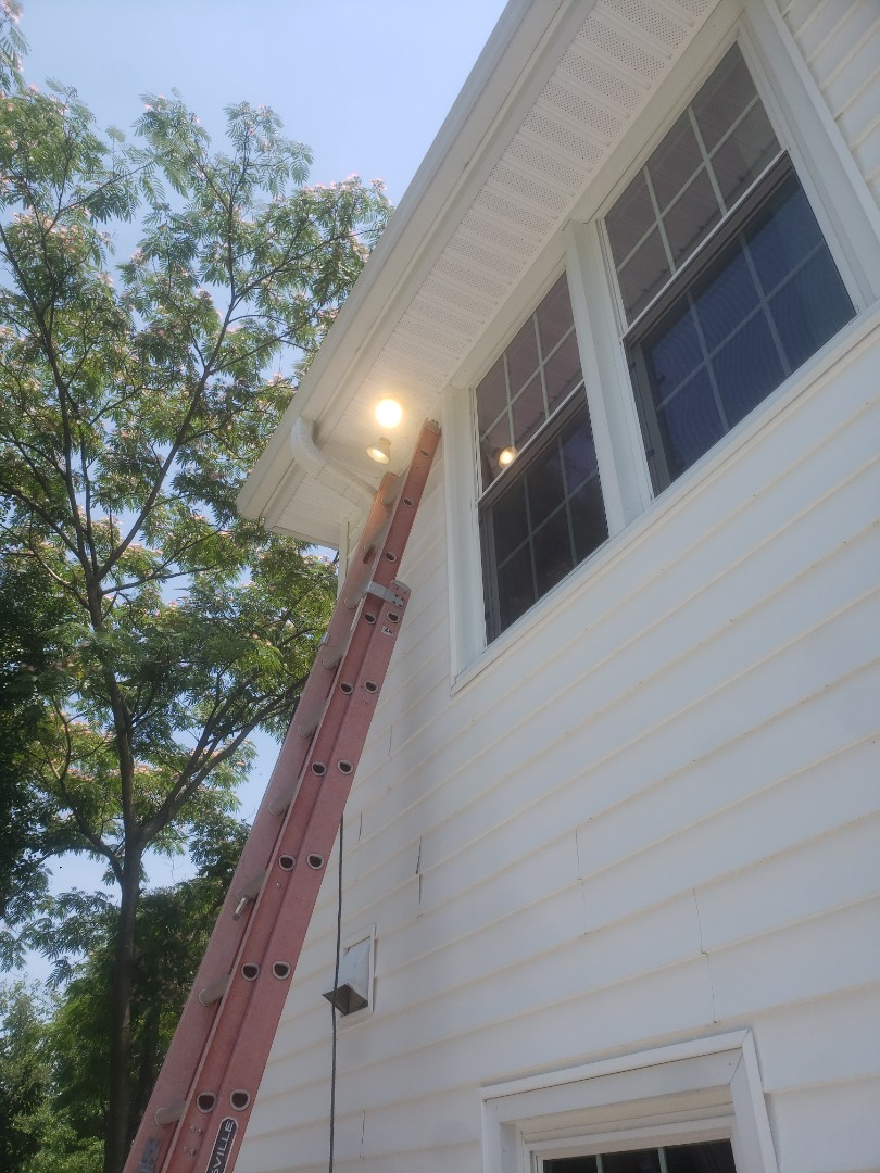 Prewire and install customer supplied flood lights, also bedroom light and living room light