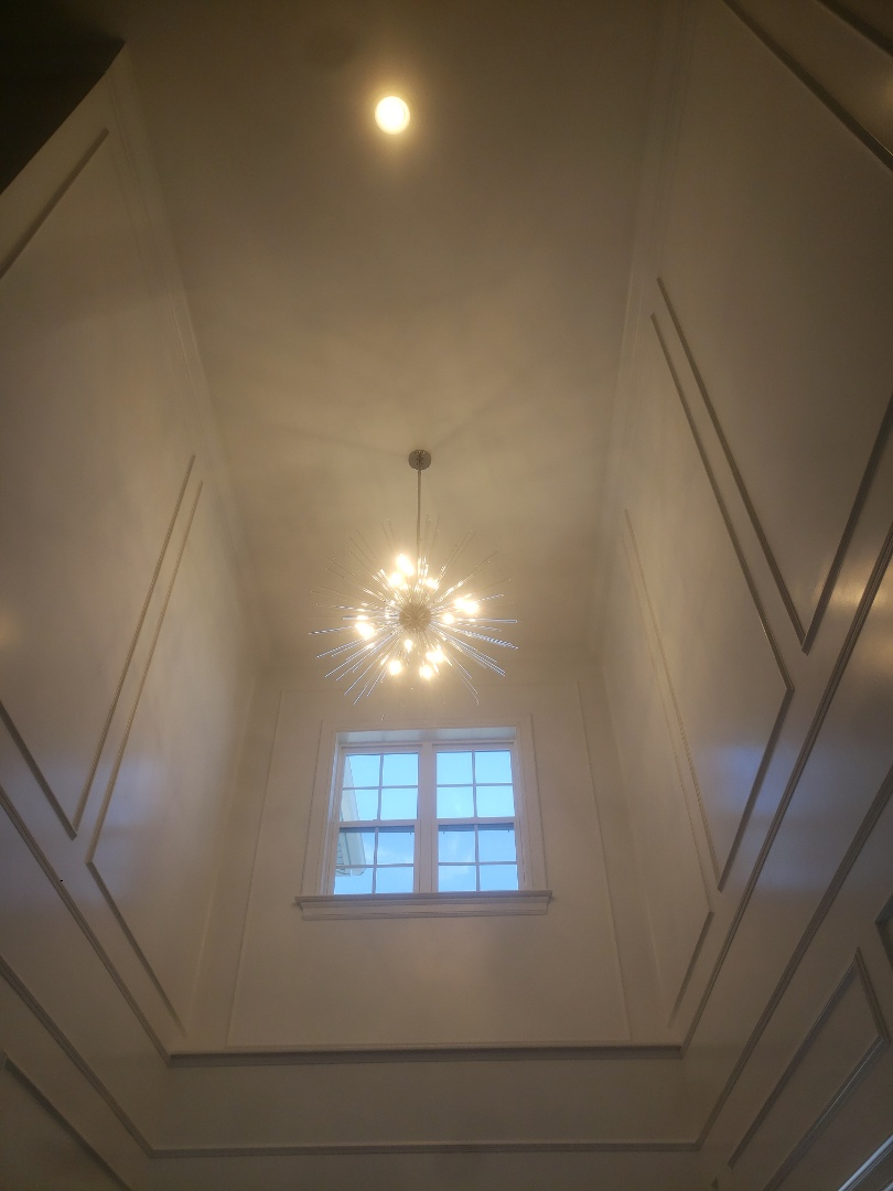 Install two new chandeliers in foyer and dining room