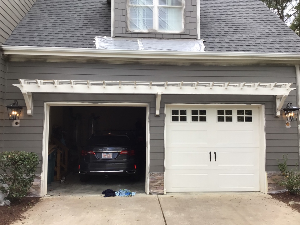 Relocate coach lights on garage.