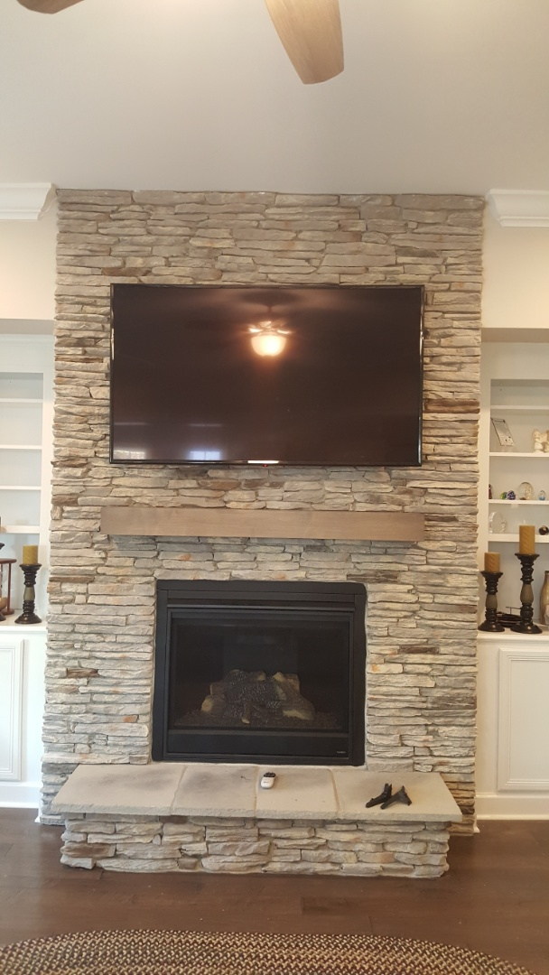 Install tv above fireplace