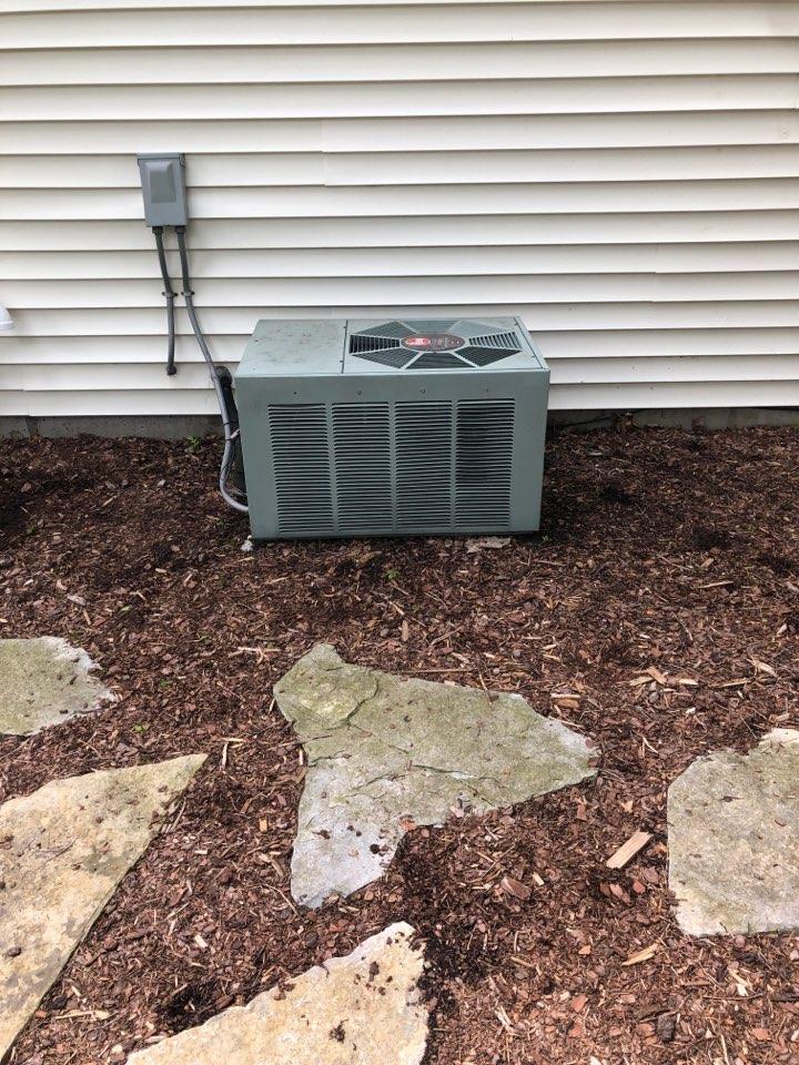 Sussex, WI - Spring Maintenance. Tune up on Rheem Air Conditioner.
