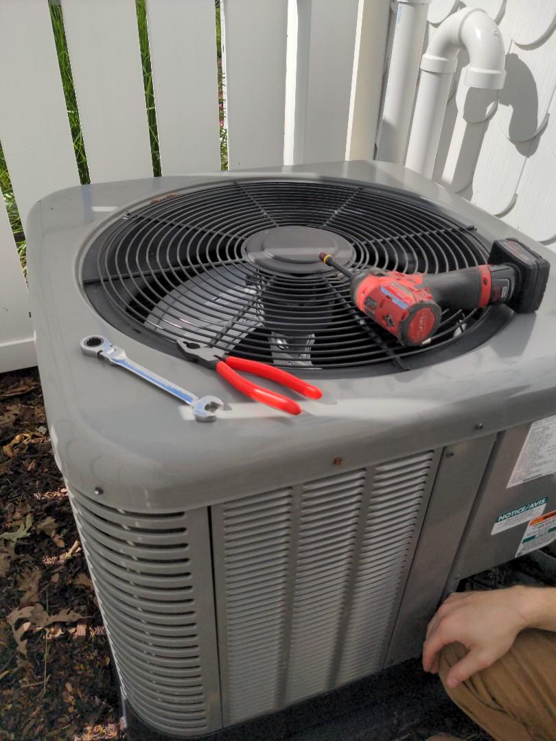 Menomonee Falls, WI - Maintenance on Rheem air conditioner