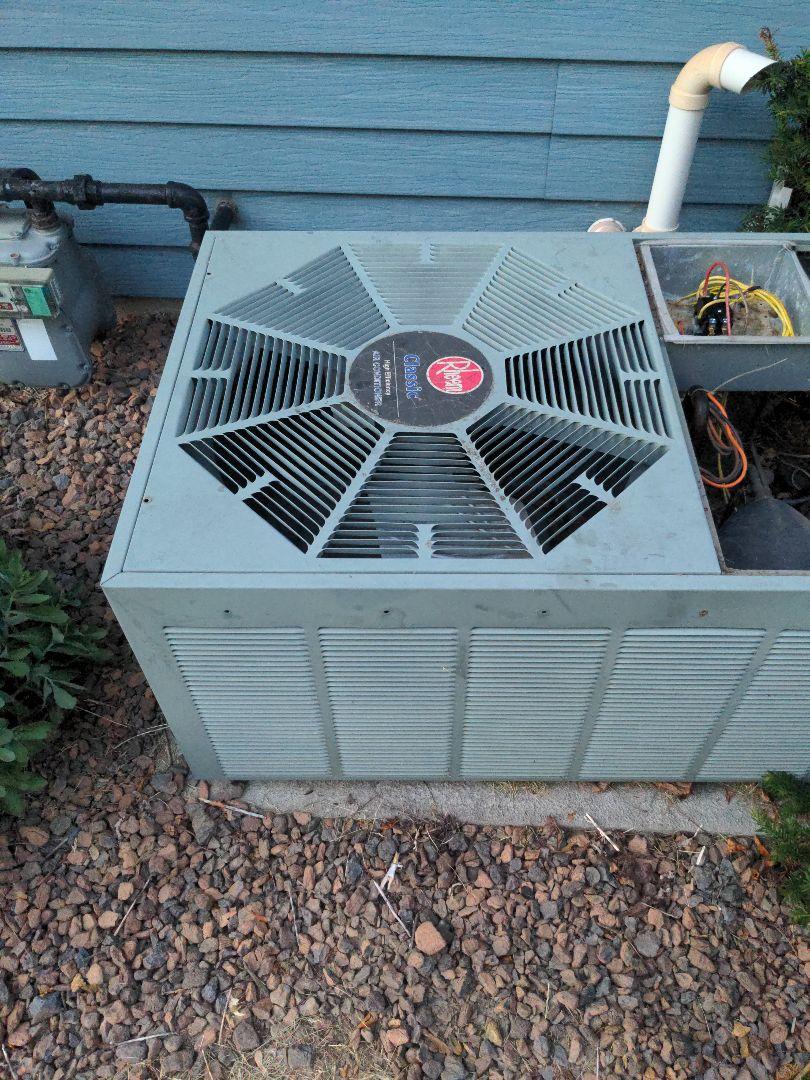 Sussex, WI - Service Rheem air conditioner