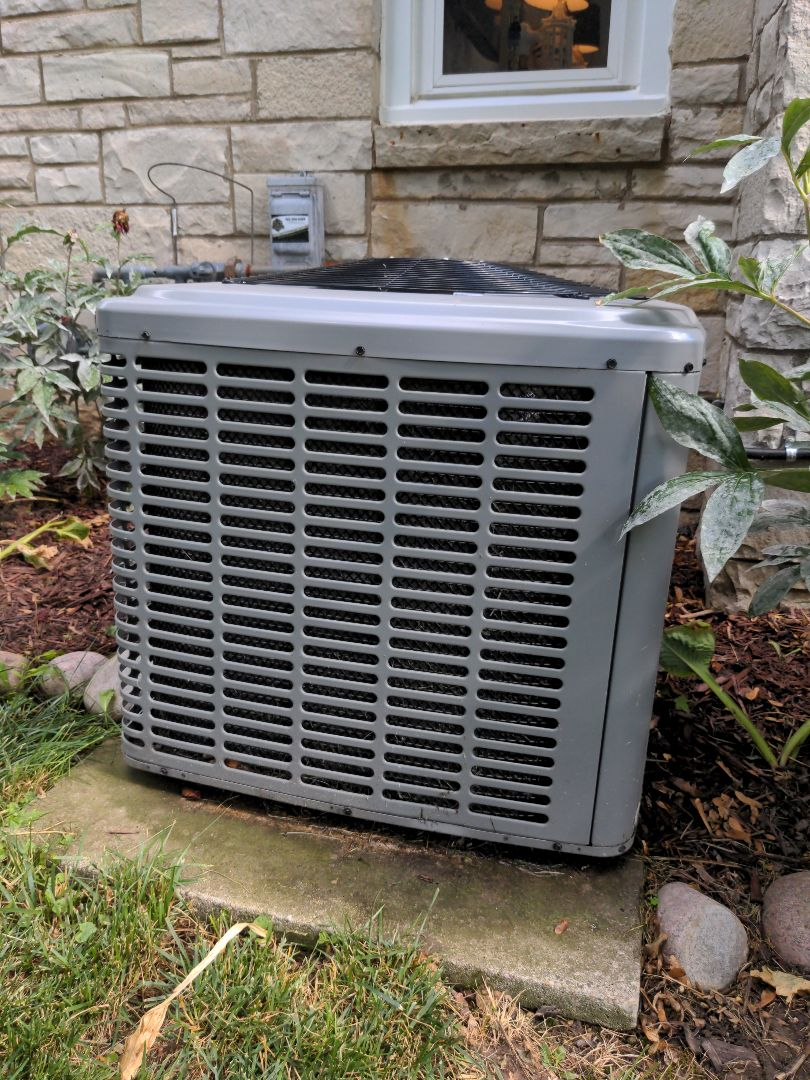 Elm Grove, WI - Air conditioner maintenance on Luxaire equipment
