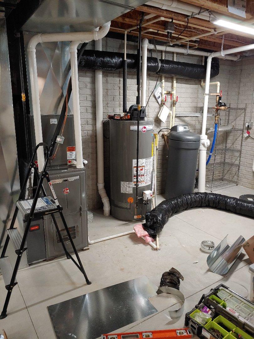 Menomonee Falls, WI - Install fresh air intake on rheem furnace