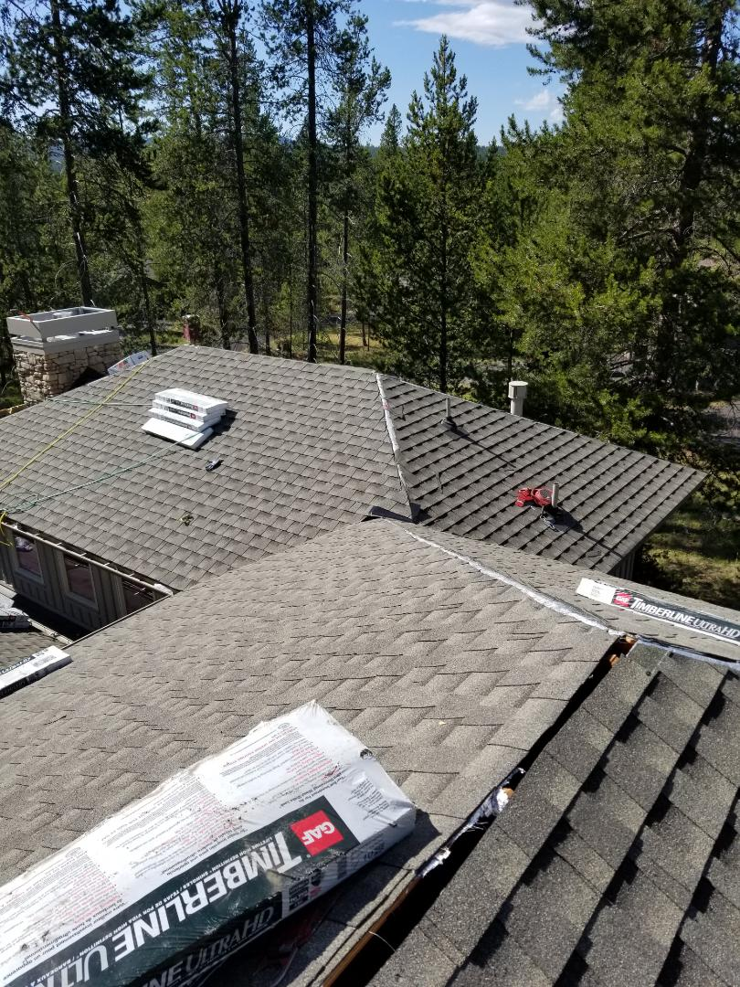 Sunriver, OR - Finishing installing a beautiful GAF Timberline Ultra HD asphalt shingle roof in Sunriver with Ridglass and ThermaSheet radiant barrier underlayment to help prevent ice dams.