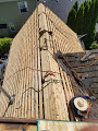 Tualatin, OR - Installing OSB sheathing on an old cedar shake skip sheathing roof in Tualatin and replacing it with GAF Timberline HD Charcoal asphalt shingles.