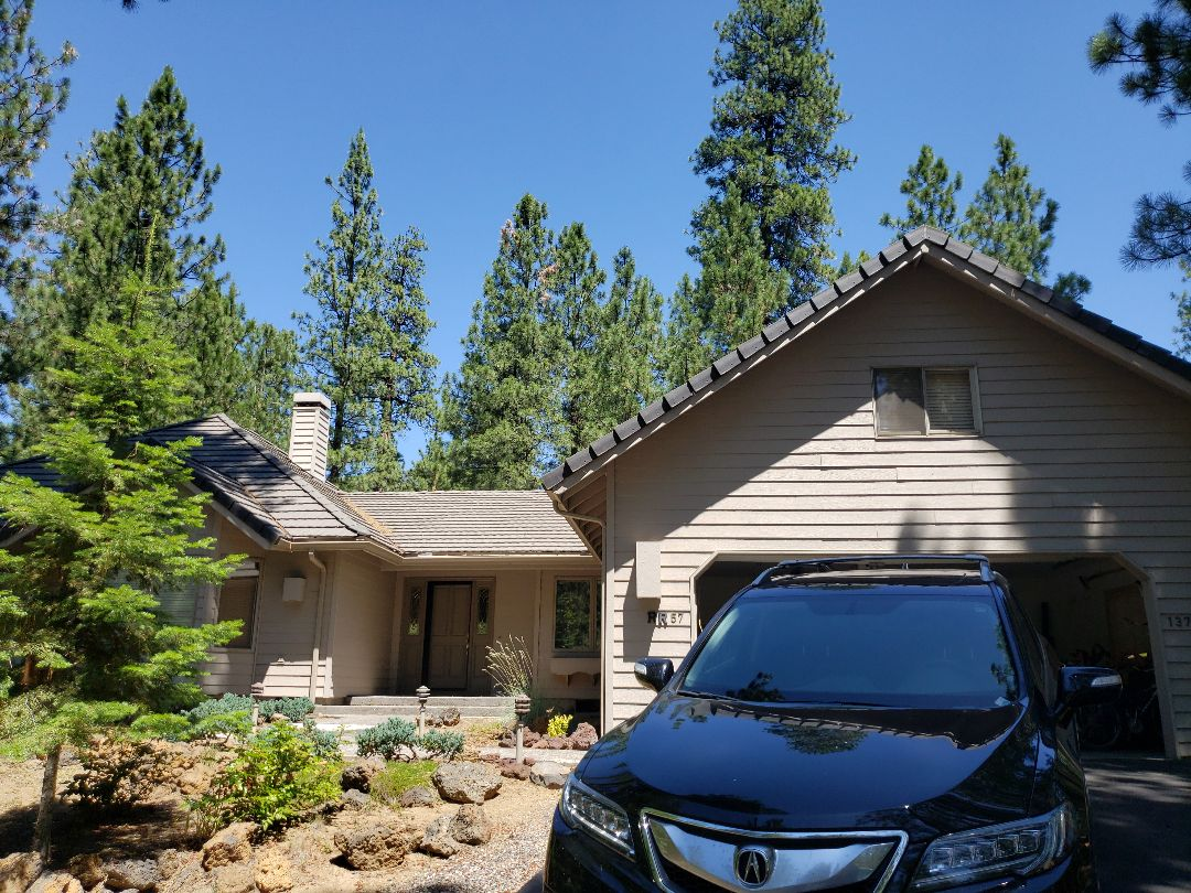 Sisters, OR - Replacing tile roof with either GAF TIMBERLINE ILTTA HD or standing seam metal in Black Butte.