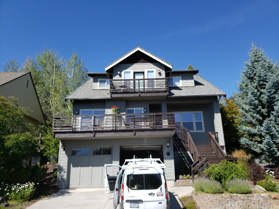 Bend, OR - Measuring for a composition roof replacement with ridge vent.