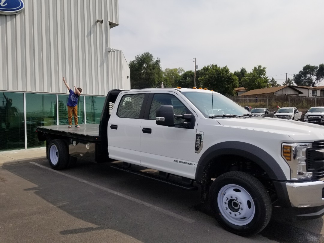 Madras, OR - Just picked up a new Ford F-550 upfitted with a 12 ft Knapheide flatbed at TS&S Ford in Madras. This will help with our roof shingle deliveries.