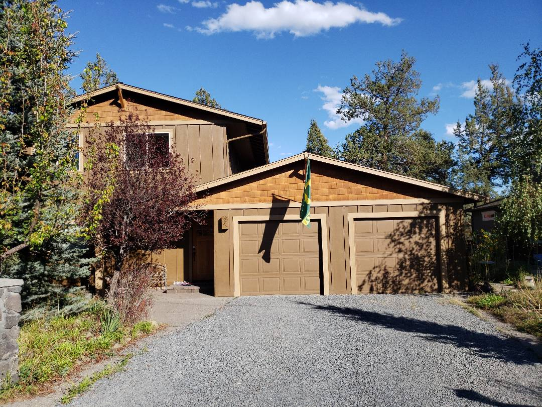 Bend, OR - Evaluating hail damage on a single roof with gutters.