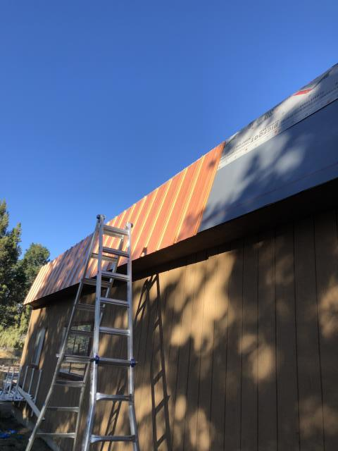 Bend, OR - Replacing a composition shingle roof in Bend with Standing Seam Holly Panel metal in Copper Penny.