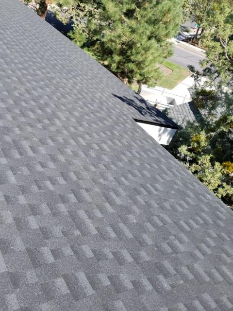 Bend, OR - Installed a new roof with GAF Timberline HD architectural style composite shingles in Charcoal color using GAF FeltBuster synthetic felt and GAF Pro-Start starter shingles.