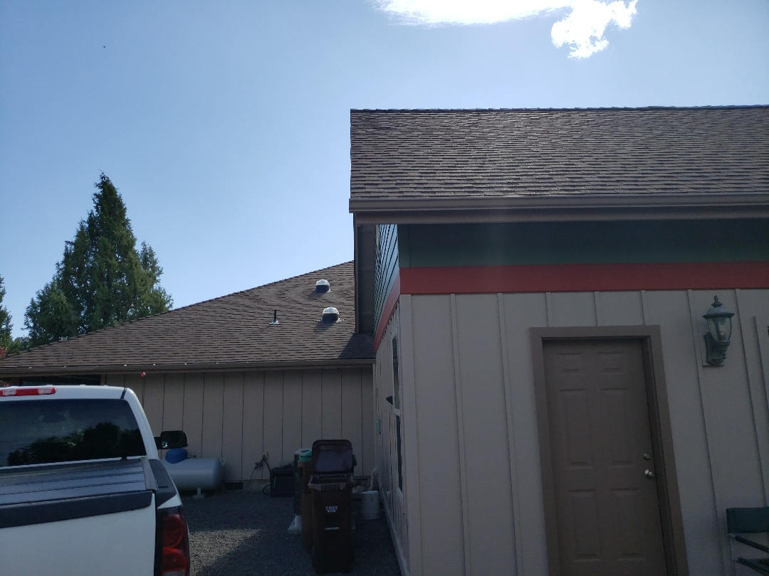 Prineville, OR - Inspecting for an insurance claim for hail damage to a composition roof.