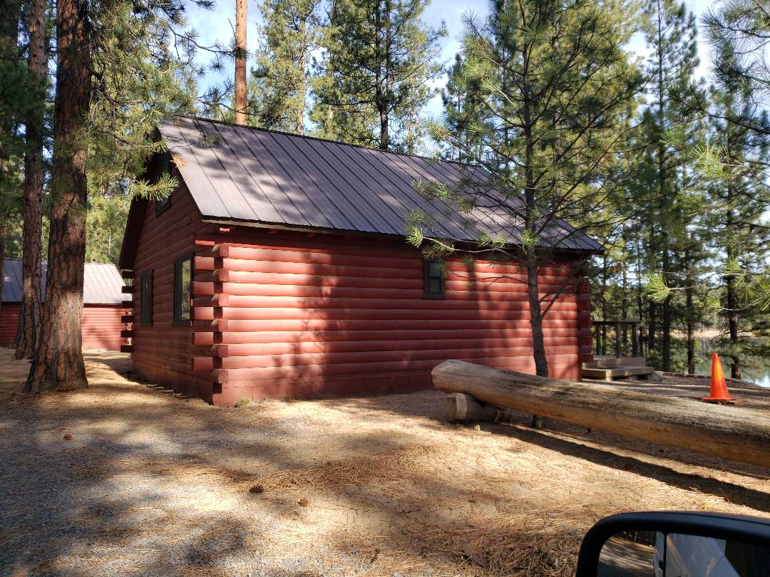 La Pine, OR - Measuring to replace the standing seam metal roof.