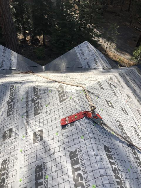 Portland, OR - Replacing a composition shingle roof in Bend with Standing Seam Metal Roofing in Charcoal Grey.