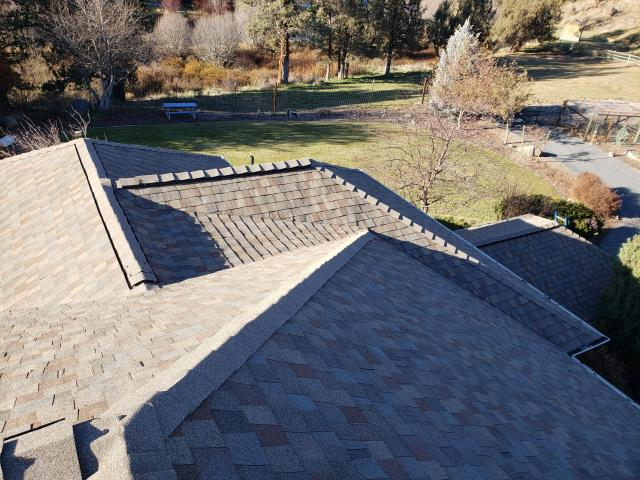 La Pine, OR - Replacing a composition shingle roof in Bend with Owens Corning Oakridge Architectural shingles in Desert Tan.