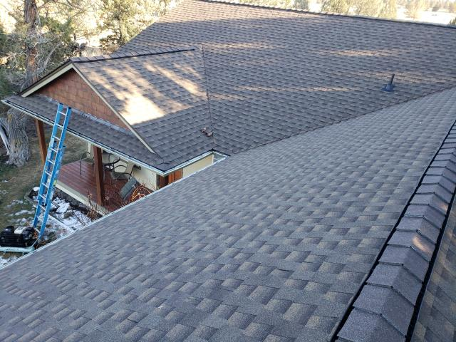 Bend, OR - Replacing a composition shingle roof in Sunriver with GAF Timberline Ultra HD architectural style shingles in Weathered Wood.