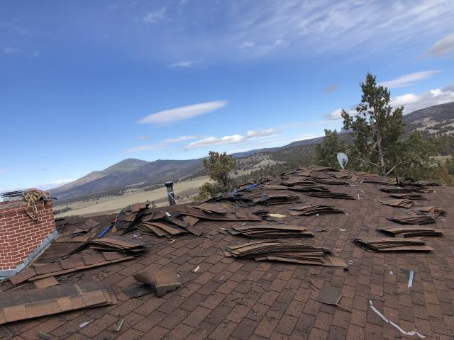 Prineville, OR - Replacing a composition shingle roof in Prineville with GAF Timberline HD architectural style shingles in Weathered Wood.