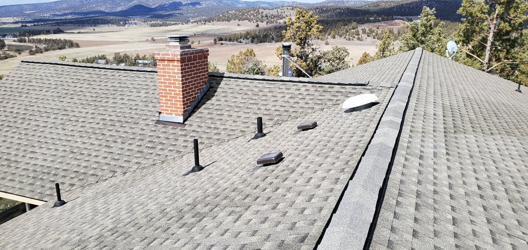 Prineville, OR - Installed a beautiful composite shingle roof in Prineville with GAF Timberline HD in Weathered Wood with an included GAF System Plus extended warranty.