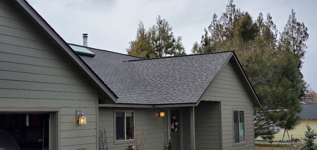 Bend, OR - Replaced an asphalt shingles roof in Tumalo with beautiful IKO Cambridge shingles in Driftwood color.