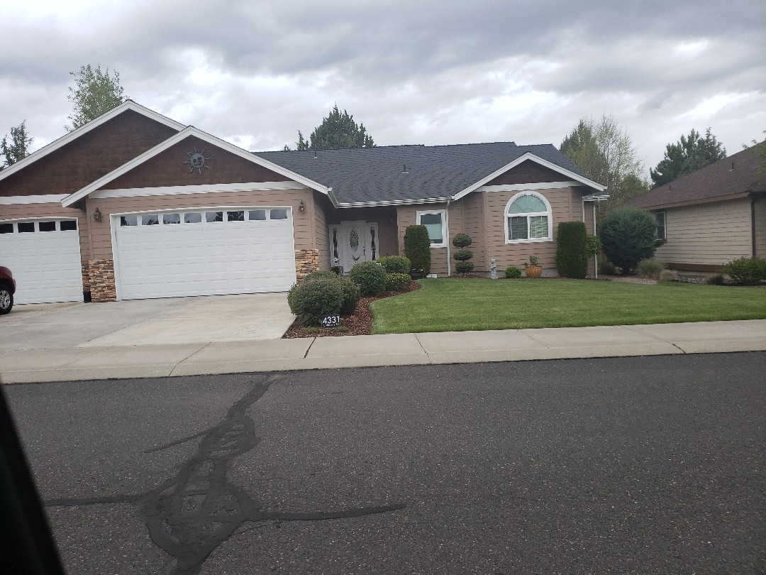 Redmond, OR - Bidding to replace a composition roof with GAF TIMBERLINE due to hail damage.