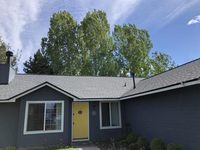 Redmond, OR - Replacing a composition shingle roof in Redmond with GAF Timberline HDZ architectural style shingles in Pewter Gray.