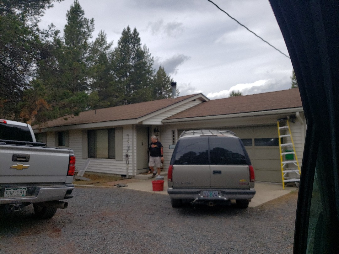 Bend, OR - Bidding to replace the composition roof because of hail and tree damage.
